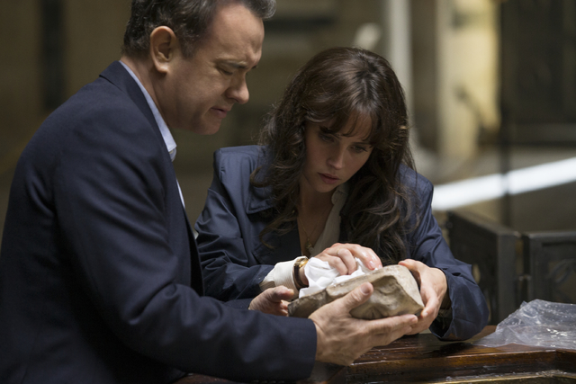 "Langdon (Tom Hanks) and Sienna (Felicity Jones) discover Dante's Death Mask in the Baptistry in ""Inferno."" (Columbia Pictures)"