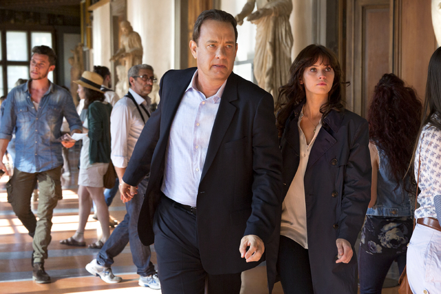 "Langdon (Tom Hanks) and Sienna (Felicity Jones) exit the Vasari corridor into the Uffizi in ""Inferno."" (Columbia Pictures)"