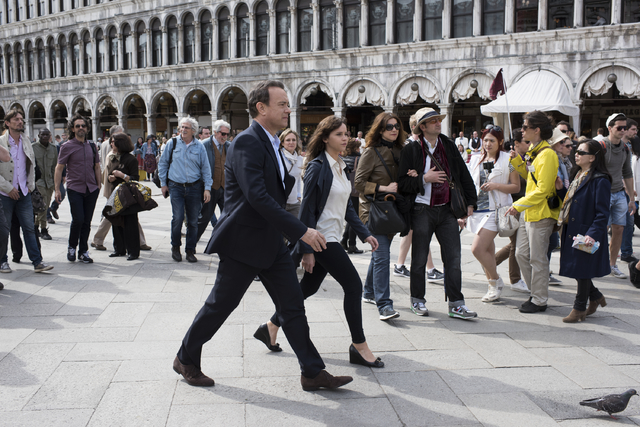 "Langdon (Tom Hanks) and Sienna (Felicity Jones) make their way through St. Mark's Square in Venice in ""Inferno."" (Columbia Pictures)"