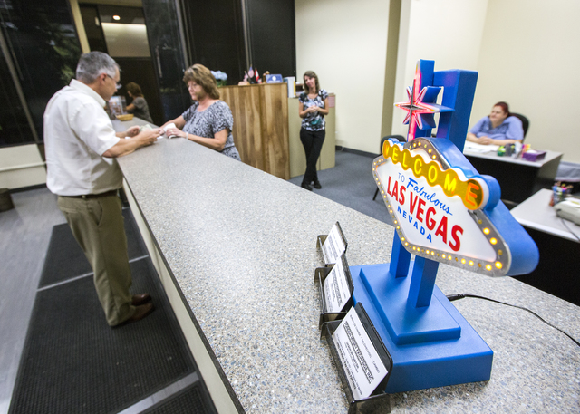 Pamela Kosmerl, right, counts out currency for costumer Jay Hagfeldt at Foreign Money Exchange, 101 Convention Center Drive, Tuesday, Aug. 30, 2016, in Las Vegas. Jeff Scheid/Las Vegas Review-Jour ...
