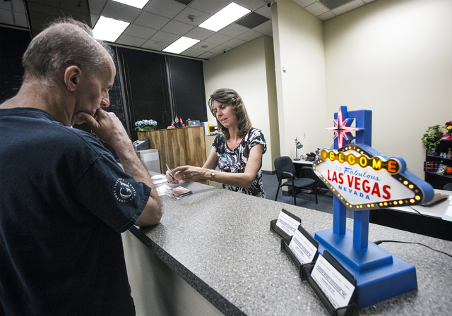 Elizabeth Kawski, right, counts out currency for a costumer Jay Hagfeldt at Foreign Money Exchange, 101 Convention Center Drive, Tuesday, Aug. 30, 2016, in Las Vegas. Jeff Scheid/Las Vegas Review- ...