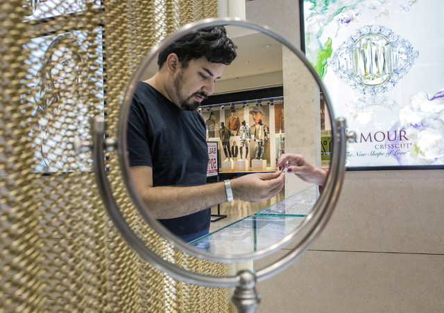 A reflection of a customer is seen while he looks views a ring at Berger & Sons at the Fashion Show on Tuesday, Aug. 30, 2016. Jeff Scheid/Las Vegas Review-Journal Follow @jeffscheid