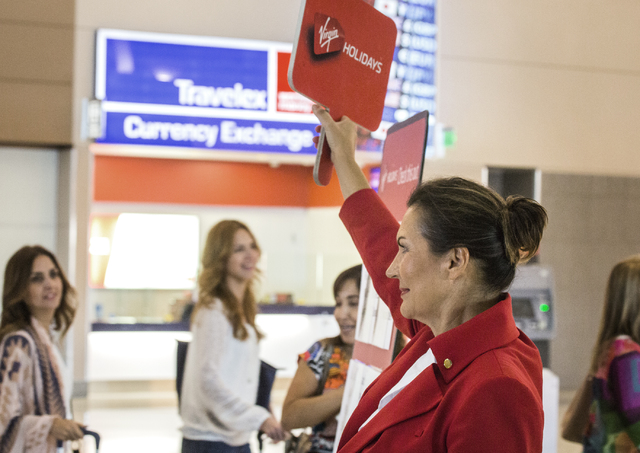 Tina Lederman with Virgin Holidays waits Friday, Sept. 02, 2016 for passengers arriving on Virgin Airline flight from Gatwick, England  to Terminal 3 at McCarran International Airport. Jeff Scheid ...