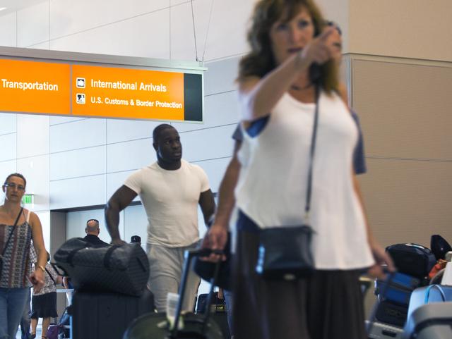 Passengers walk in Terminal 3 at McCarran International Airport after clearing customs on Friday, Sept. 02, 2016. Jeff Scheid/Las Vegas Review-Journal Follow @jeffscheid