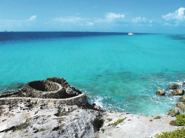 This November 2012 photo shows the view of Cancun across the bay from the southernmost point of Isla Mujeres, also known as Punta Sur, where visitors can walk on developed trails amid dramatic cli ...