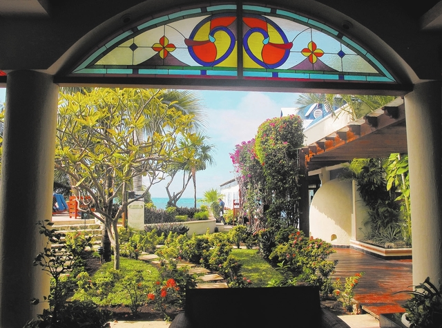 This November 2012 photo shows the view from inside the idyllic, Italian villa-styled Villa Rolandi hotel, which overlooks the bay off Isla Mujeres, Mexico. Isla Mujeres, or Island of Women, is a  ...