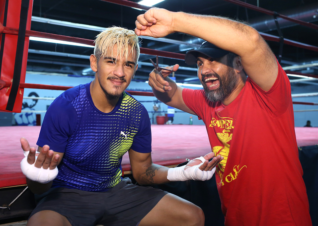 Las Vegan Jessie Magdaleno (left) and his trainer Manny Robles joke around after a workout last week. (Mikey Williams)