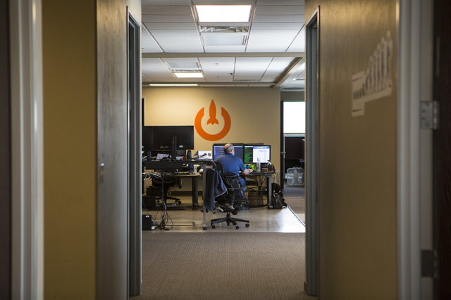 Senior Engineer Adam Englander works at his desk at LaunchKey, a Las Vegas-based technology company that was recently acquired by Portland, Oregon-based iovation, on Friday, Oct. 14, 2016. (Mirand ...