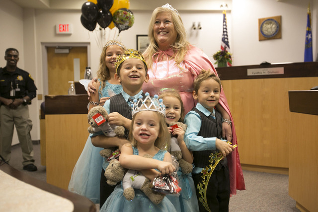 District Court Family Judge Cynthia Giuliani poses with Jessie, 9, from left, Chase, 6, Nevaeh, 3, Leslie, 4, and Kenny, 5, after finalizing the adoption process with their new family at Family Co ...