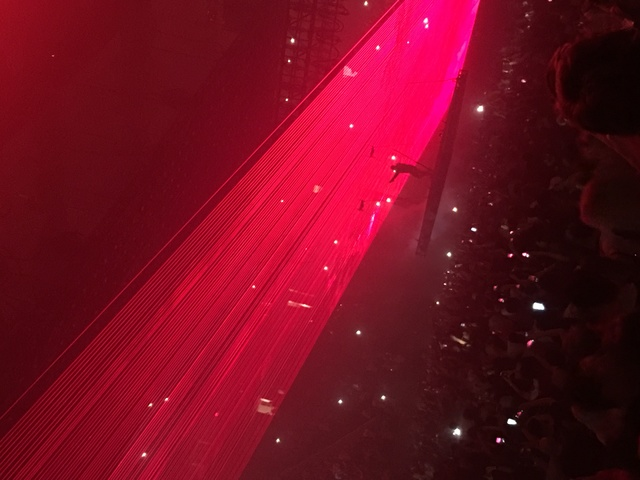 Kanye West performs for 18,000 fans on his elevated stage at T-Mobile Arena o Saturday night. (John Katsilometes photo)