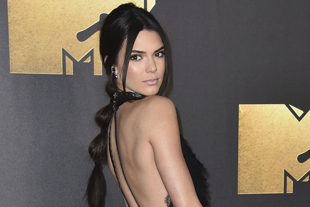 In this April 9, 2016 file photo, Kendall Jenner arrives at the MTV Movie Awards in Burbank, Calif. Jenner appeared in a downtown Los Angeles courtroom on Thursday, Oct. 13, 2016, to testify again ...