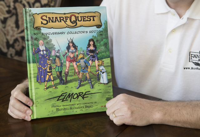 Maxwell Alexander Drake holds up his restoration of SnarfQuest at his home in North Las Vegas on Thursday, Oct. 6, 2016. He successfully crowdfunded the project in 2014. (Loren Townsley/Las Vegas  ...