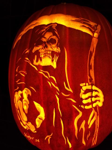 "A grim reaper design on a foam pumpkin carved by Bryan Yeager in the ""Killerpumpkin.net"" exhibit at Centennial Hills Library Oct. 8, 2016, in Las Vegas. Lisa Valentine/View"