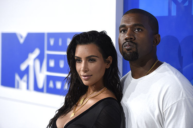Kim Kardashian West, left, and Kanye West arrive at the MTV Video Music Awards in New York in August. (Photo by Evan Agostini/Invision/AP, File)