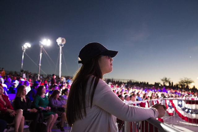 Staff member Margarita Romero watches the presidential debate during the Hillary for NevadaDebate Watch Party at Craig Ranch Regional Park on Wednesday, Oct. 19, 2016, in North Las Vegas. Er ...