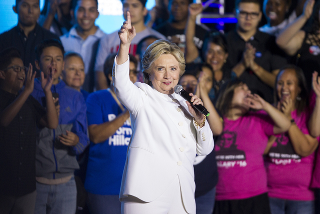Democratic presidential nominee Hillary Clinton gestures to the crowd as she takes the stage during an unscheduled stop to a Hillary for NevadaDebate Watch Party at Craig Ranch Regional Park ...