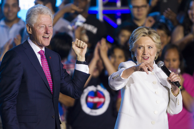 Former President Bill Clinton and Democratic presidential nominee Hillary Clinton speak during an unscheduled stop to a Hillary for NevadaDebate Watch Party at Craig Ranch Regional Park on W ...