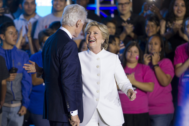 Former President Bill Clinton is introduced by his wife and Democratic presidential nominee Hillary Clinton during an unscheduled stop to a Hillary for NevadaDebate Watch Party at Craig Ranc ...