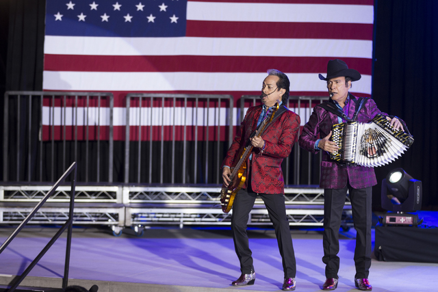 Mexican music group members of Los Tigres del Norte Hernan Hernandez, left, and his brother Jorge perform during the Hillary for NevadaDebate Watch Party at Craig Ranch Regional Park on Wednesda ...