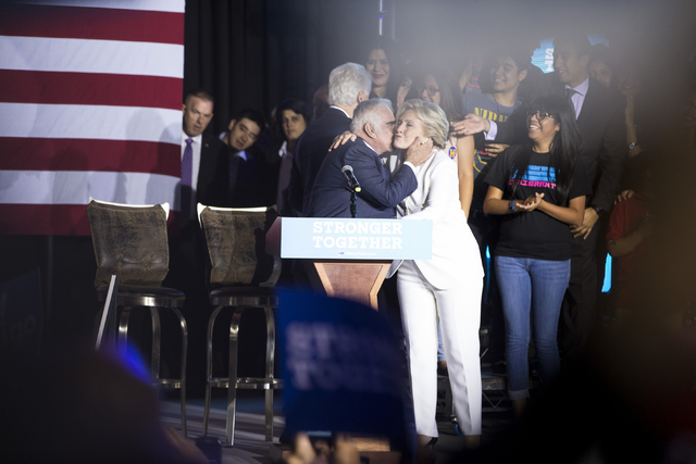 Mexican music legend Vicente Fernandez greets Democratic presidential nominee Hillary Clinton to the stage during an unscheduled stop to a Hillary for NevadaDebate Watch Party at Craig Ranch ...