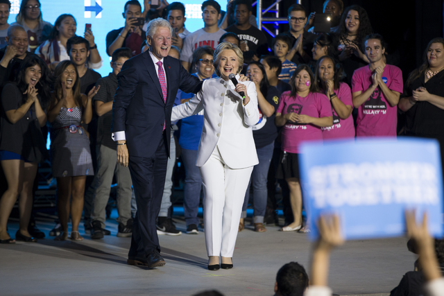 Former President Bill Clinton and his wife Democratic presidential nominee Hillary Clinton take the stage during an unscheduled stop to a Hillary for NevadaDebate Watch Party at Craig Ranch  ...