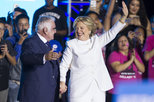 Mexican music legend Vicente Fernandez introduces Democratic presidential nominee Hillary Clinton to the stage during an unscheduled stop to a Hillary for NevadaDebate Watch Party at Craig R ...