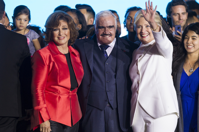 Actress and singer Angelica Maria, from left, Mexican music legend Vicente Fernandez, and Democratic presidential nominee Hillary Clinton pose for photos during an unscheduled stop to a Hillary fo ...