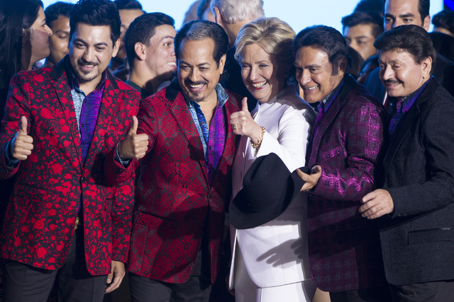 Democratic presidential nominee Hillary Clinton takes a photo with members of the Mexican music band Los Tigres del Norte during an unscheduled stop to a Hillary for NevadaDebate Watch Party ...