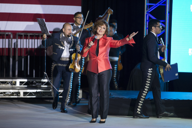 Mexican actress and singer Angelica Maria performs during an unscheduled stop to a Hillary for NevadaDebate Watch Party at Craig Ranch Regional Park on Wednesday, Oct. 19, 2016, in North Las ...