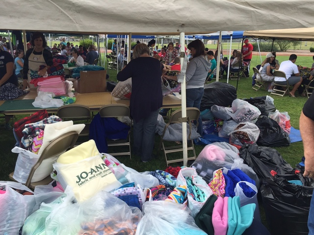 The 2015 Community Day of Service event saw a large number of participants. The one-day effort, spearheaded by The Church of Jesus Christ of Latter-day Saints, is hoping to exceed its blanket crea ...
