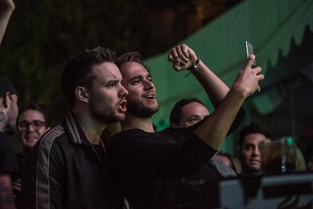 One Direction singer Liam Payne joins DJ Zedd on stage Saturday, Oct. 22, at the Wynn's Intrigue nightclub. (Karl Larson Photography)