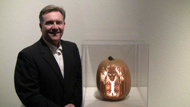 """Summerlin resident Bryan Yeager with his pumpkin carving on display in the exhibit """"Killerpumpkin.net"""" at the Summerlin Library in 2014. View file photo"""