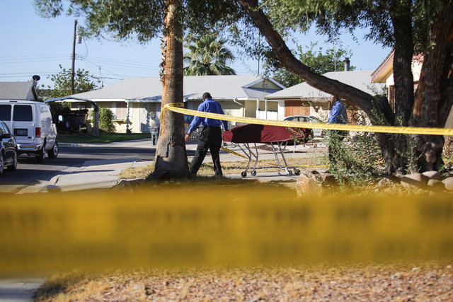 A body is removed from 313 Lilac Lane, where Metro was investigating an apparent homicide in Las Vegas on Aug. 12, 2016. (Brett Le Blanc/Las Vegas Review-Journal) Follow @bleblancphoto