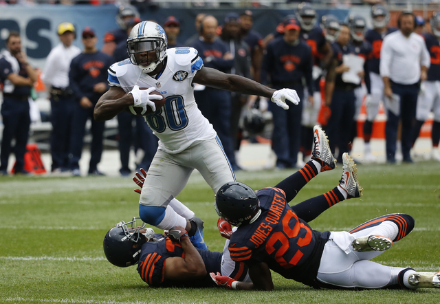 Detroit Lions wide receiver Anquan Boldin (80) runs against Chicago Bears defense after receiving a pass during the second half of an NFL football game, Sunday, Oct. 2, 2016, in Chicago. (AP Photo ...