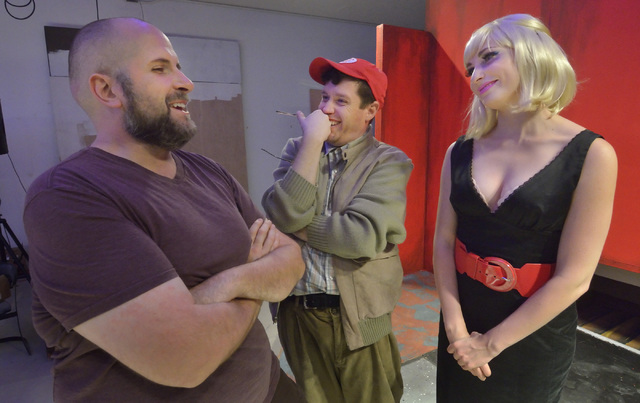 """Director Troy Heard, left, talks with actors Cory Benway, center, and Kady Heard during a rehearsal for """"Little Shop of Horrors"""" in Alios at 1217 S. Main St. in Las Vegas on Monday,  ..."""