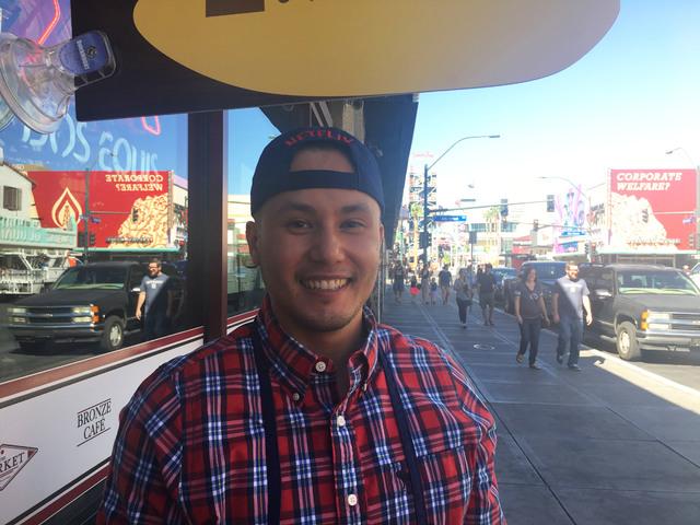 Peter Bastien, owner of Bronze Cafe at the Market stands under the Luke's Diner sign. (Janna Karel/Las Vegas-Review Journal)