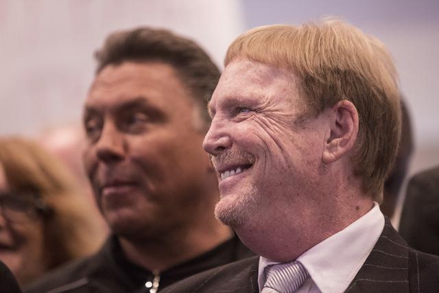 Oakland Raiders owner Mark Davis, right, smiles as Nevada Gov. Brian Sandoval signs Senate Bill 1 at the Richard TAM Alumni Center at UNLV on Monday, Oct. 17, 2016, in Las Vegas. The bill official ...
