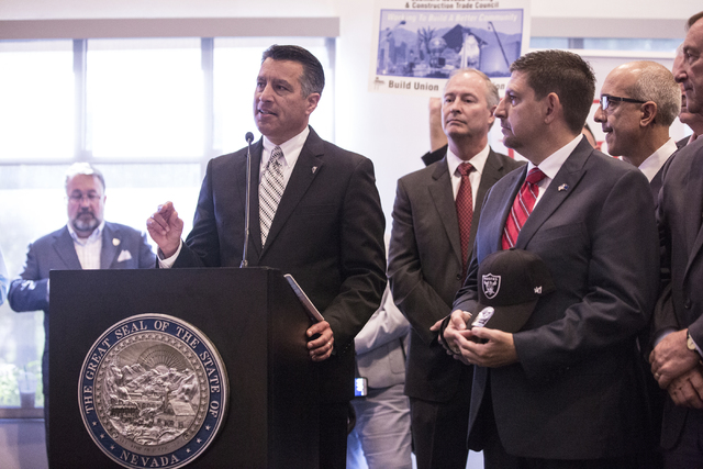 Nevada Gov. Brian Sandoval, left, address the crowd moments before signing Senate Bill 1 at the Richard TAM Alumni Center at UNLV on Monday, Oct. 17, 2016, in Las Vegas. The bill officially allows ...