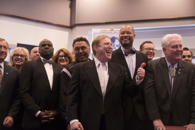 Oakland Raiders owner Mark Davis gives a thumbs up to the crowd moments before Nevada Gov. Brian Sandoval signs Senate Bill 1 at the Richard TAM Alumni Center at UNLV on Monday, Oct. 17, 2016, in  ...