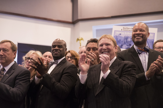 Oakland Raiders owner Mark Davis applauds the signing of Senate Bill 1 at the Richard TAM Alumni Center at UNLV on Monday, Oct. 17, 2016, in Las Vegas. The bill officially allows for a 65,000-seat ...