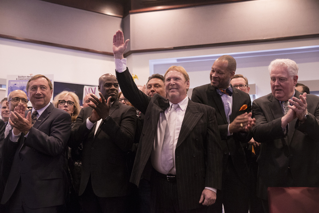 Oakland Raiders owner Mark Davis waves to the crowd moments before Nevada Gov. Brian Sandoval signed Senate Bill 1 at the Richard TAM Alumni Center at UNLV on Monday, Oct. 17, 2016, in Las Vegas.  ...