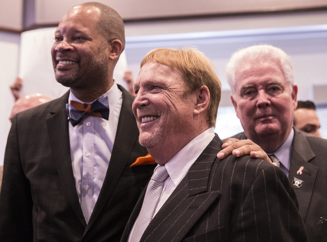 Oakland Raiders owner Mark Davis poses for photos moments after Gov. Brian Sandoval signed Senate Bill 1 at the Richard TAM Alumni Center at UNLV on Monday, Oct. 17, 2016, in Las Vegas. The bill o ...