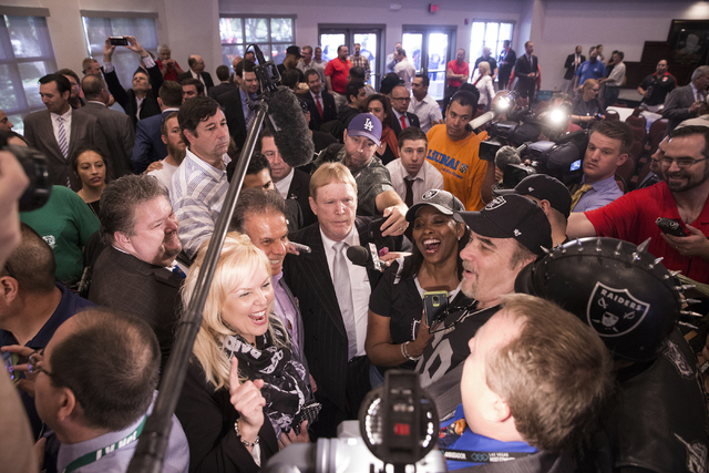 Oakland Raiders owner Mark Davis, middle, takes questions from the media moments after Gov. Brian Sandoval signed Senate Bill 1 at the Richard TAM Alumni Center at UNLV on Monday, Oct. 17, 2016, i ...