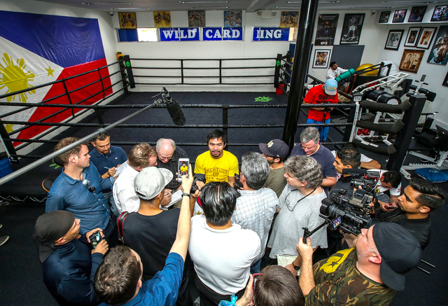 Manny Pacquiao talks to reporters during his Los Angeles media day last week. (Photo by Mikey Williams)