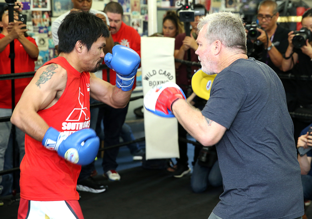 Manny Pacquiao (left) trains with Freddie Roach at a Los Angeles media day last week. (Photo by Mikey Williams)