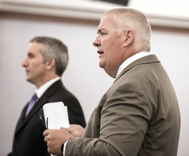 Prosecutor Giancarlo Pesci, left, and defense attorney Scott Coffee stand during the initial court appearance for Kenneth McDonald at the Regional Justice Court on Wednesday, Oct. 19, 2016. McDona ...