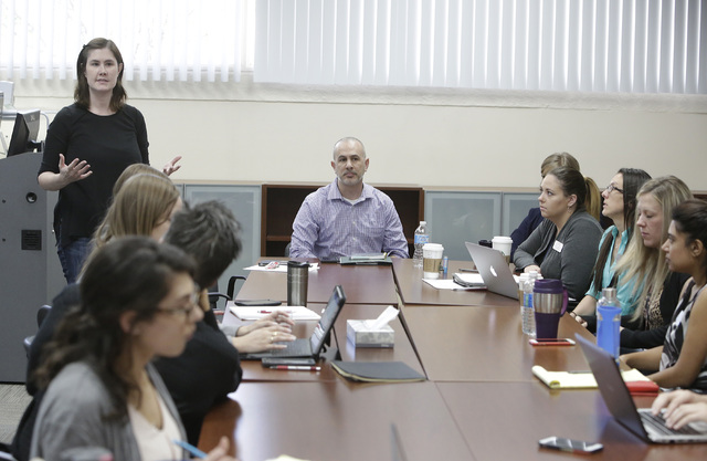 Dr. Noelle Lefforge speaks during a staff meeting with professors and students who are training to be psychologists, Thursday, Oct. 6, 2016, at mental health clinic and training facility for maste ...