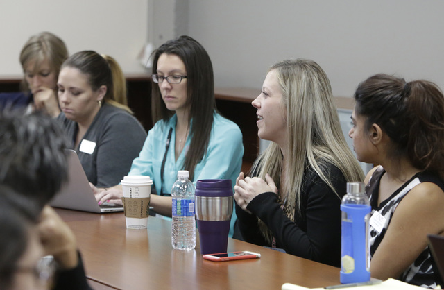 Grace Ravenelle, M.S. clinical mental health counseling, second right, speaks during a staff meeting with professors and students who are training to be psychologists, Thursday, Oct. 6, 2016, at m ...