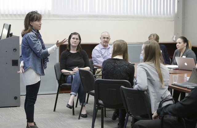Dr. Michelle Paul speaks as Dr. Noelle Lefforge, second, left, looks on during a staff meeting with professors and students who are training to be psychologists, Thursday, Oct. 6, 2016, at mental  ...