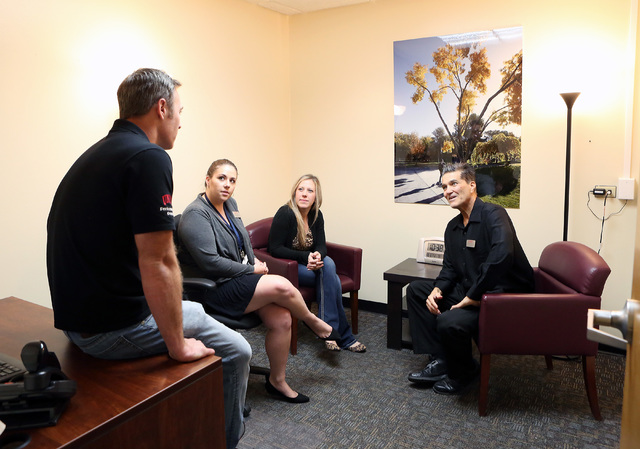 UNLV mental health students Jesse Scott, from left, Stacy Graves, Grace Ravenelle and Peter Stefanou chat prior to a staff meeting with professors and students who are training to be psychologists ...
